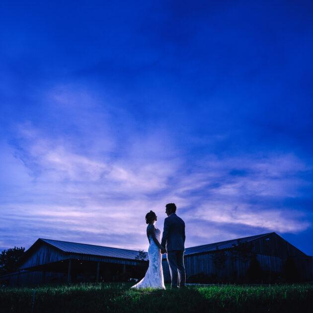 Bride and Groom against night sky wedding at Coopers Ridge