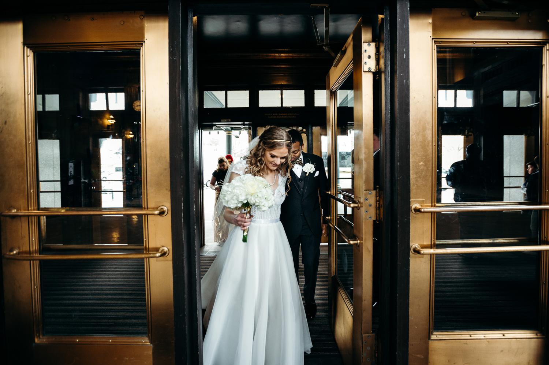 bride leading groom into union station kansas city
