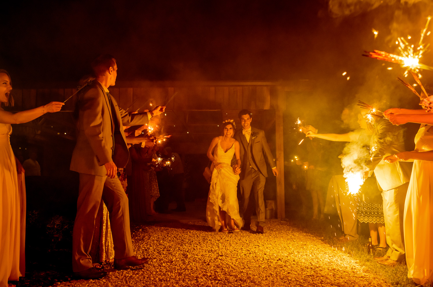 Married couple exits through sparkler tunnel Coopers Ridge