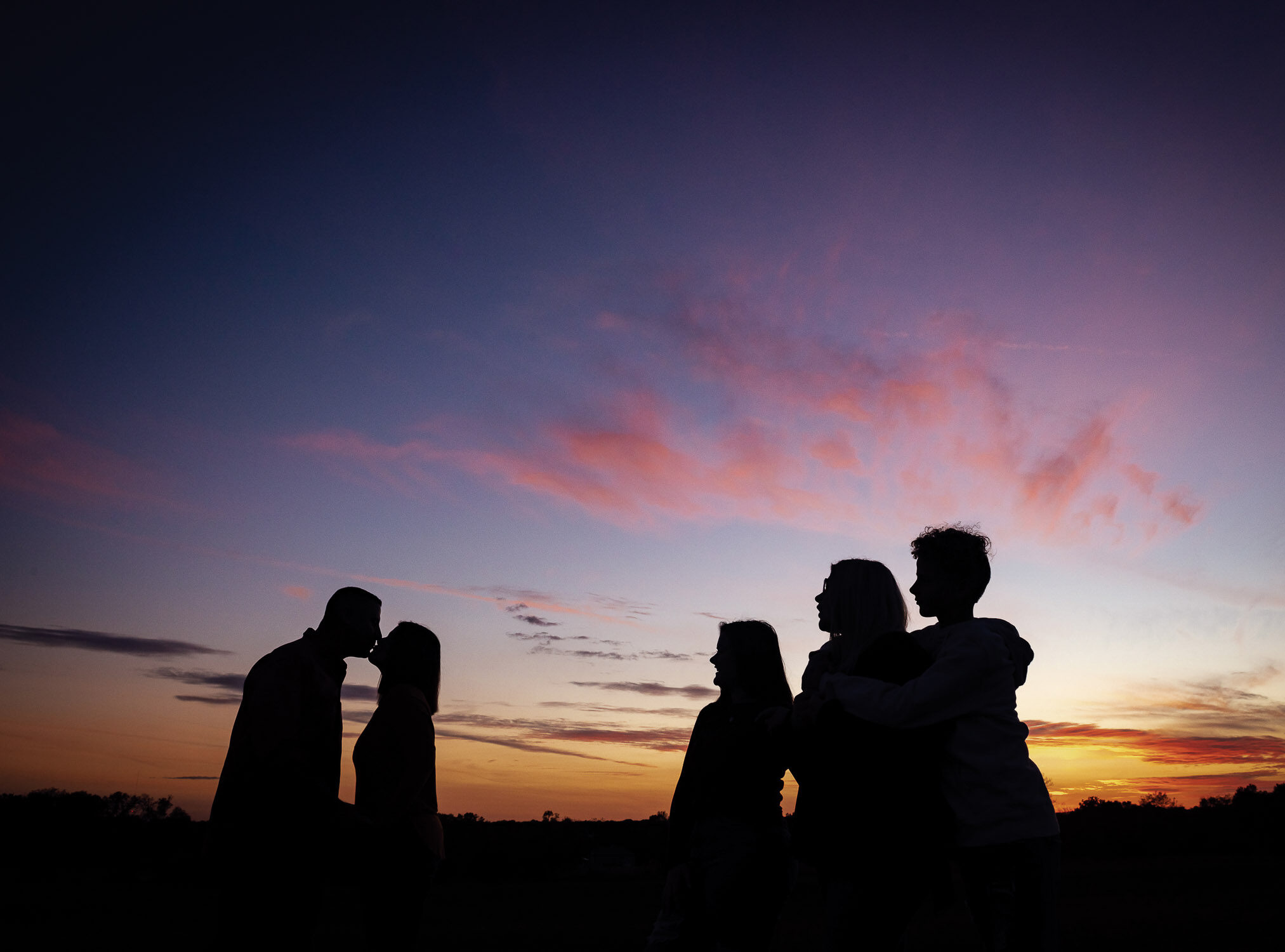 family in sunset silhouette