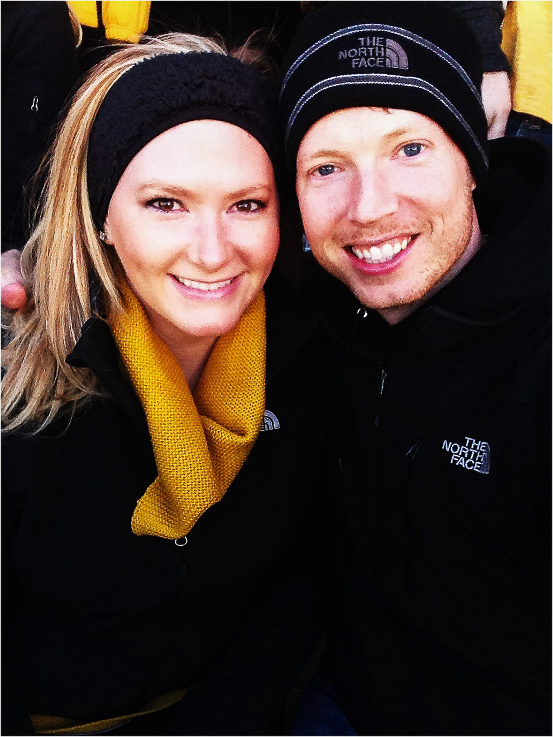 couple wearing black and gold mizzou apparel