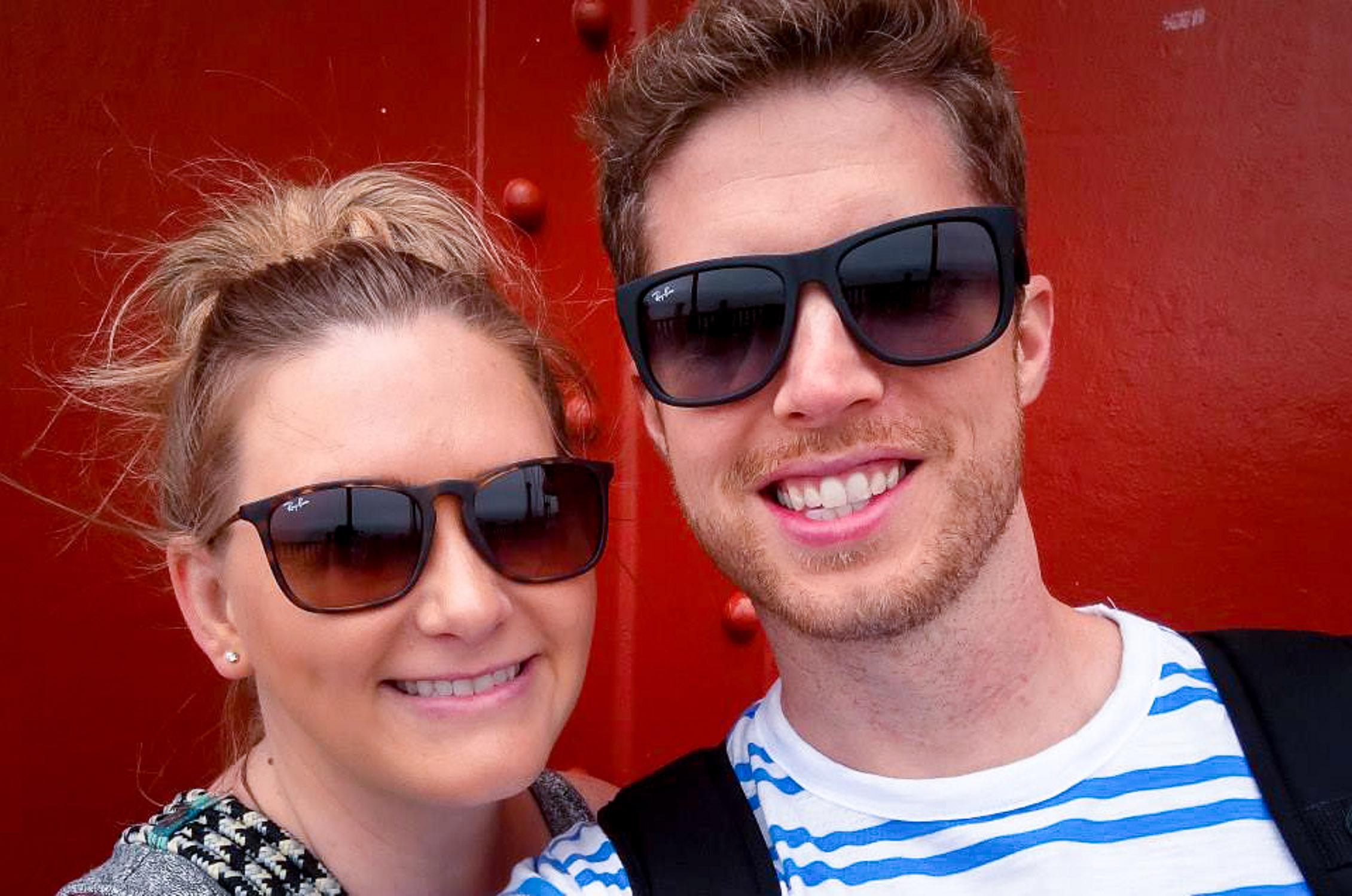 couple wearing sunglasses at golden gate bridge